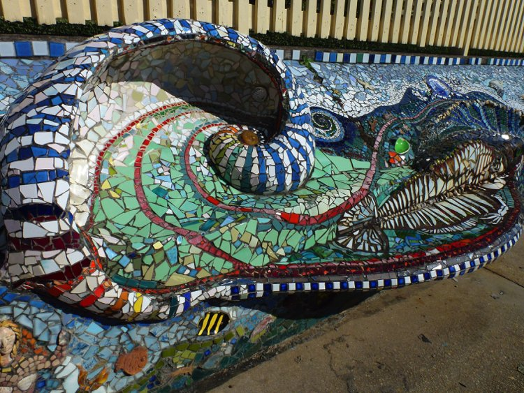 Turquoise and greens handmade mosaic artwork makes is a perfect travel destination
