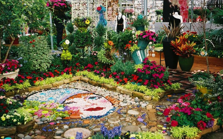 Garden mosaic portrait made of stones and marble