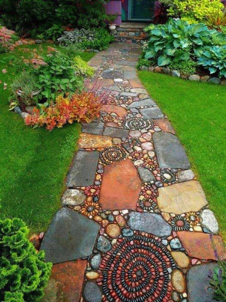 Earthy, terracotta slabs merge with intricate pebble spirals Mosaic Tiles creating gorgeous garden mosaic artwork pathway