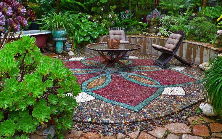 Beautiful garden mosaic rug made out of colorful natural stones