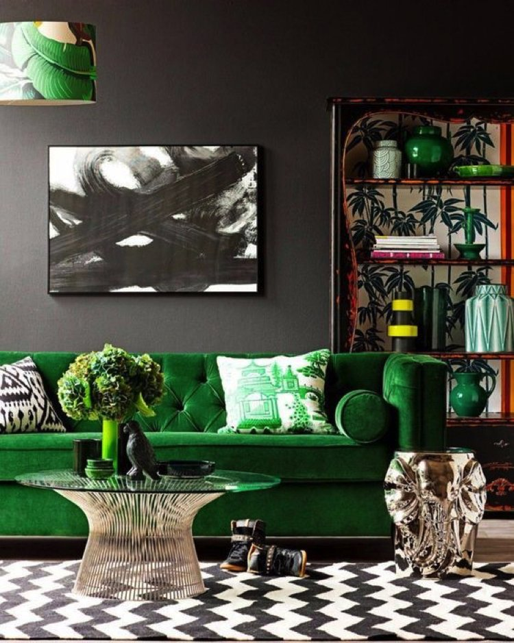 Green represents lushness and abundance and adds earthy vibes to the living room.