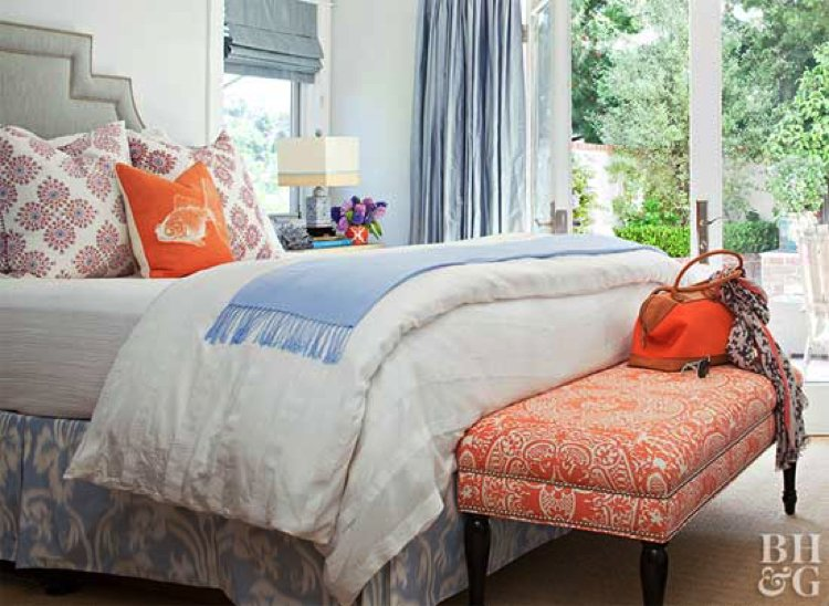 Subtle splash of orange over a bed