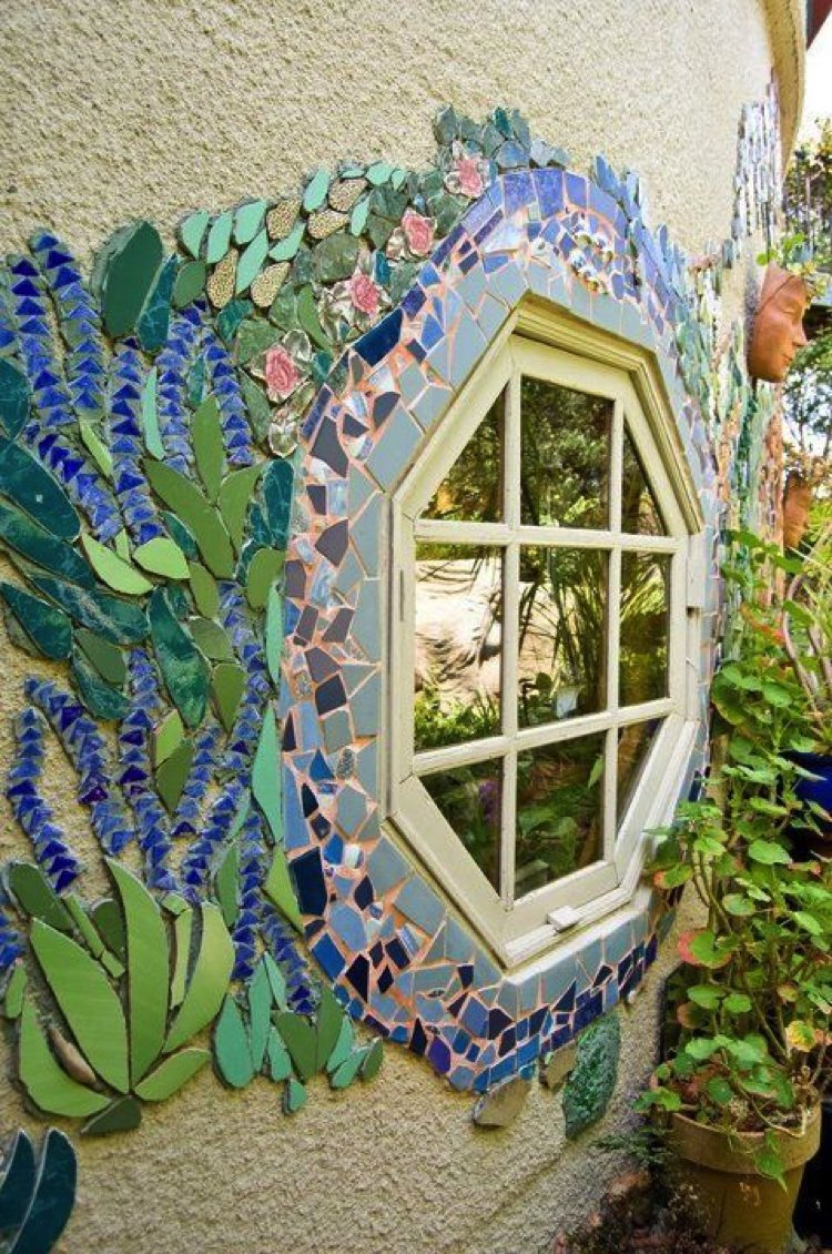 A French chalet feel surrounds this cozy hexagonal mosaic art window