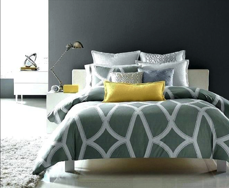 Adding a light splash of color with decorative bed pillows would make your room stand out.
