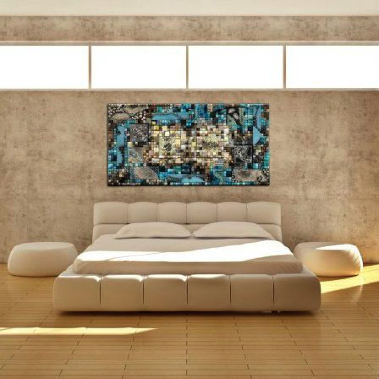 Colorful handmade mosaic artwork on the wall of a monochromatic bedroom.