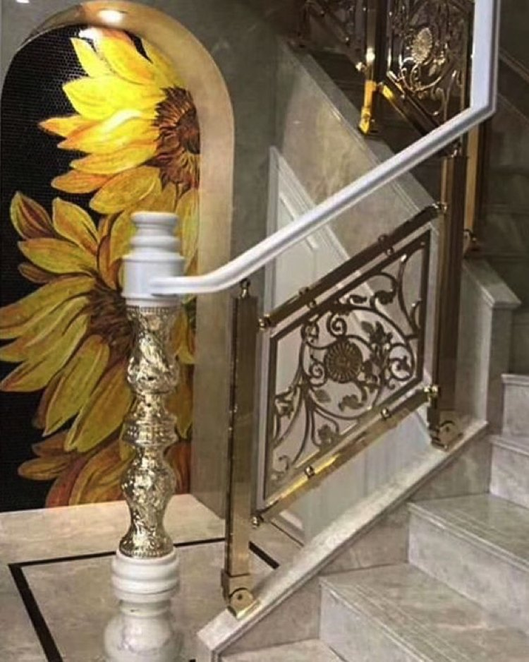 A beautiful custom mosaic artwork stands out and elevates the entrance.