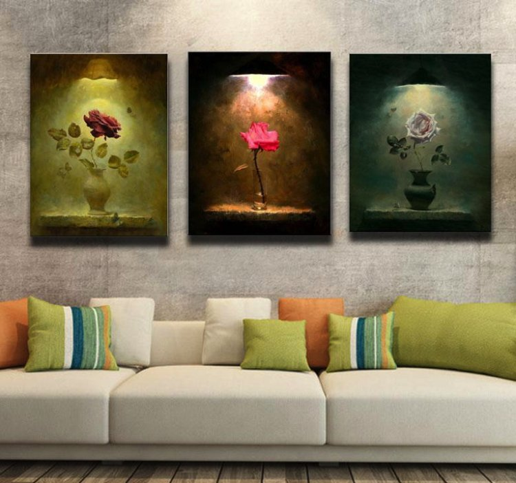 A trio of roses wall art gives the illusion of down lighting