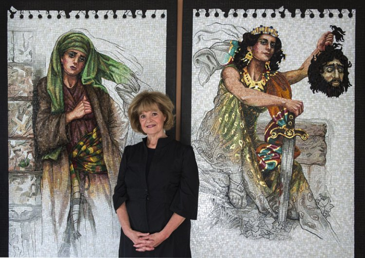 Lilian Broca stands in front of her entrancing contemporary mosaic wall art