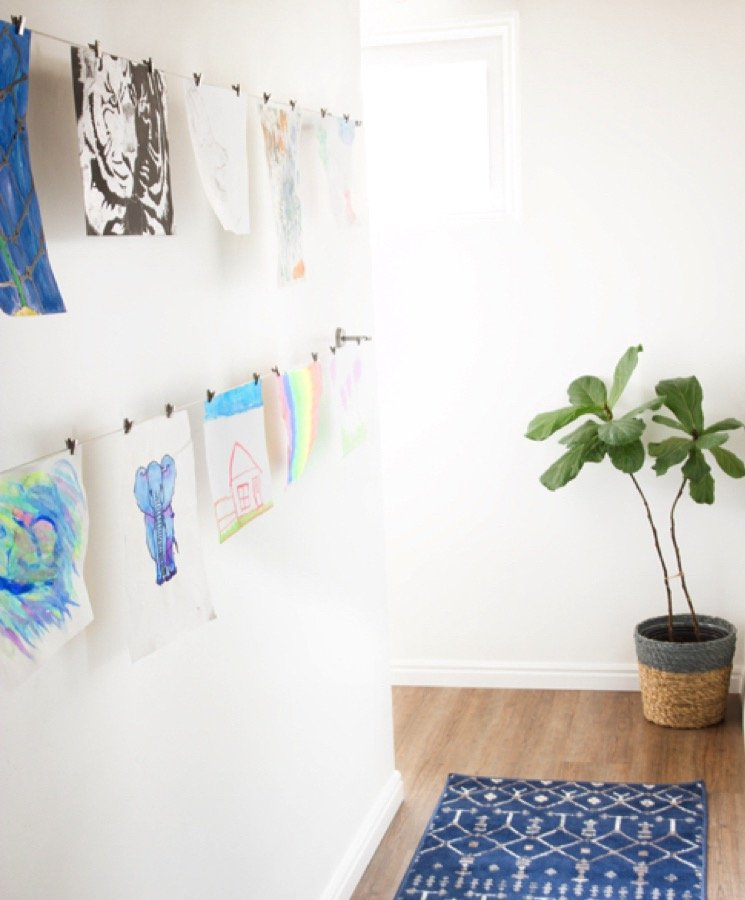 Artwork of kids' drawings can be displayed as wall art.