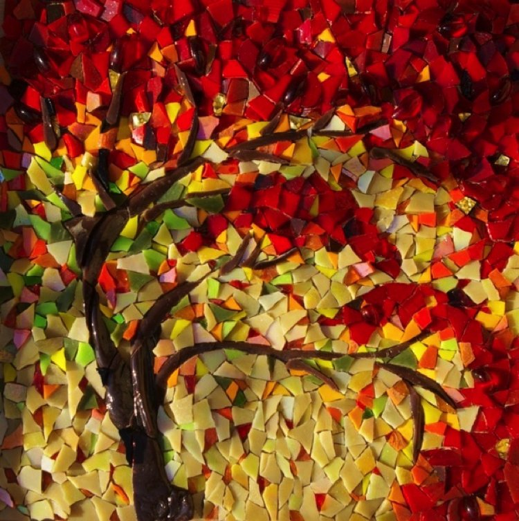 Generously laid glass pieces combine Fall inspired handmade mosaic design with a stunning array of changing colors.