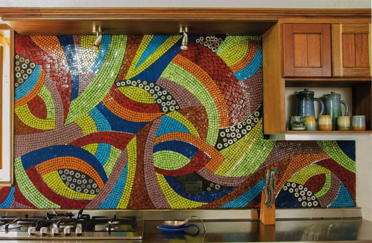 A kitchen handmade mosaic backsplash that is bold, geometric lines.