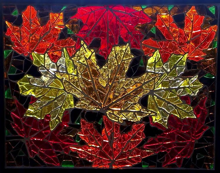 Glass mosaic design of frosty autumn leaves scattered over the streets.