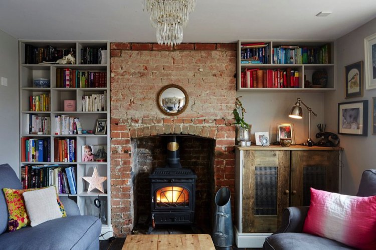 A fireplace as a focal pint in an eclectic space designed by Hart Design And Construction