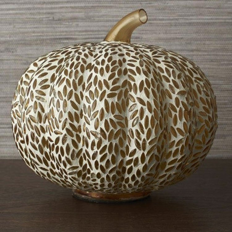 A subtle Halloween décor of a gold glass pumpkin mosaic design