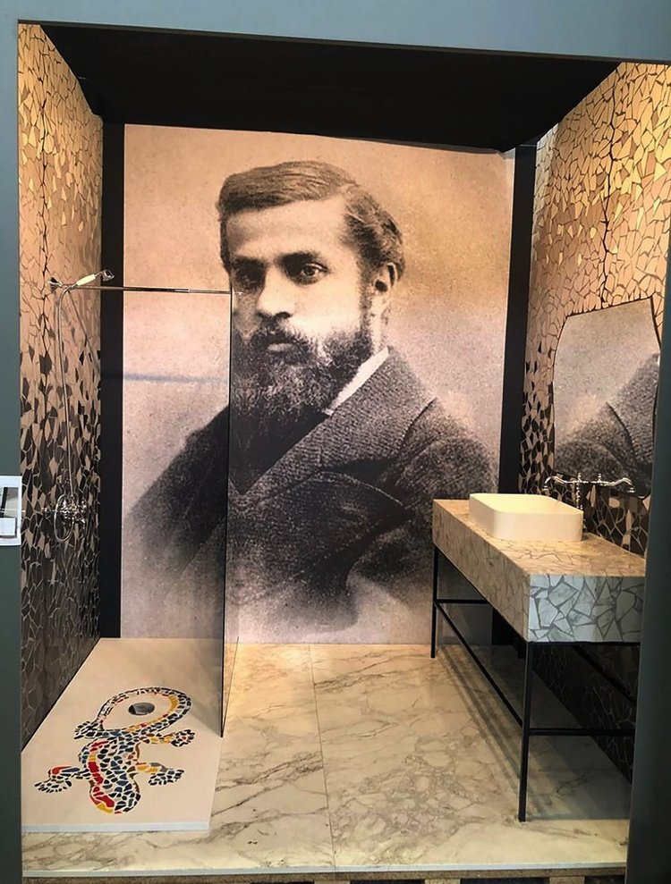 A stunning mosaic wall art portrait of the renowned architect Antoni Gaudí.