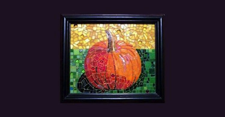 A framed picture of a Halloween mosaic design of a pumpkin