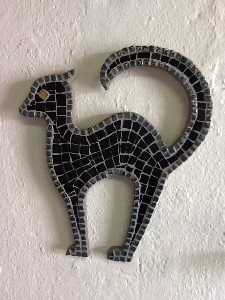 A Halloween mosaic design of a black cat