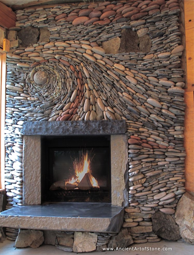 Stone mosaic artwork that adds some earthy magic to your fireplace
