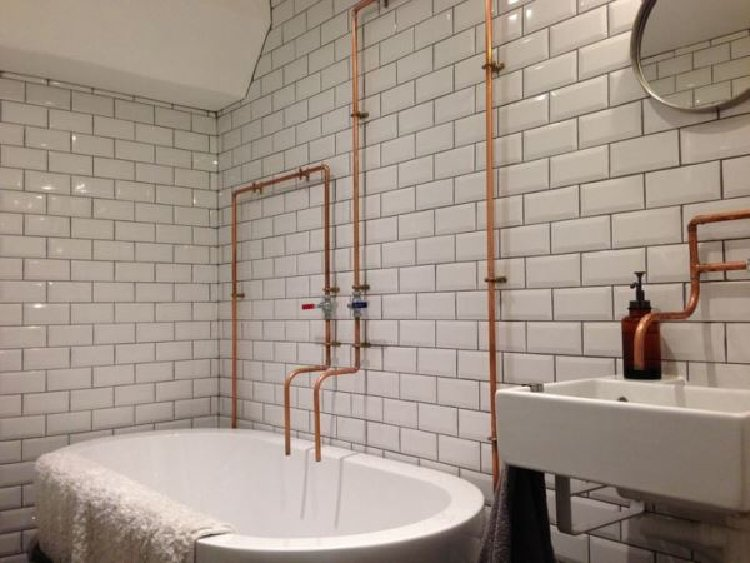 Beautiful exposed copper makes for a beautiful bathroom interiors