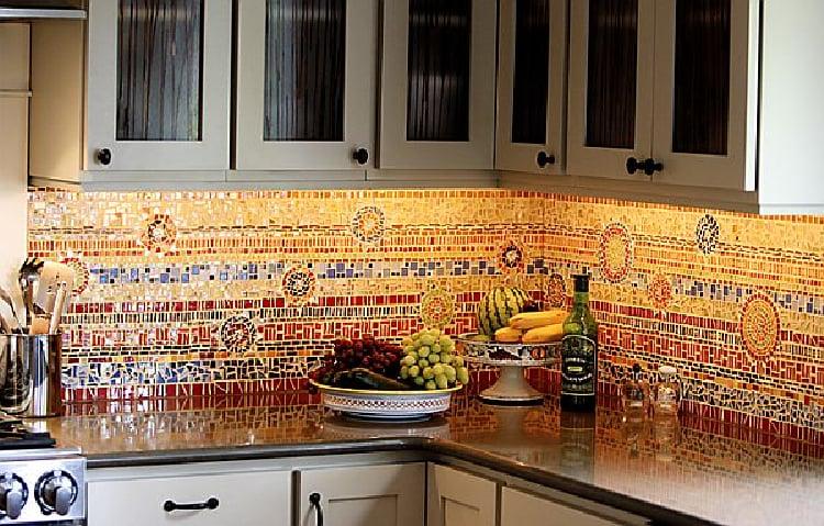 A gorgeous kitchen mosaic backsplash that incorporates lively colors.