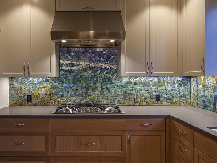 Ocean inspired mosaic kitchen backsplash.