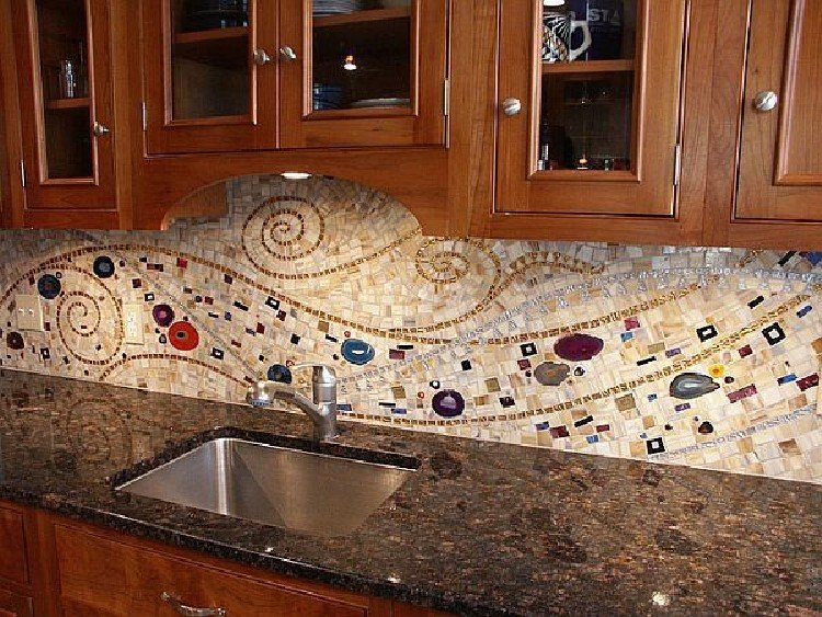 Beautiful swirling kitchen mosaic backsplash.