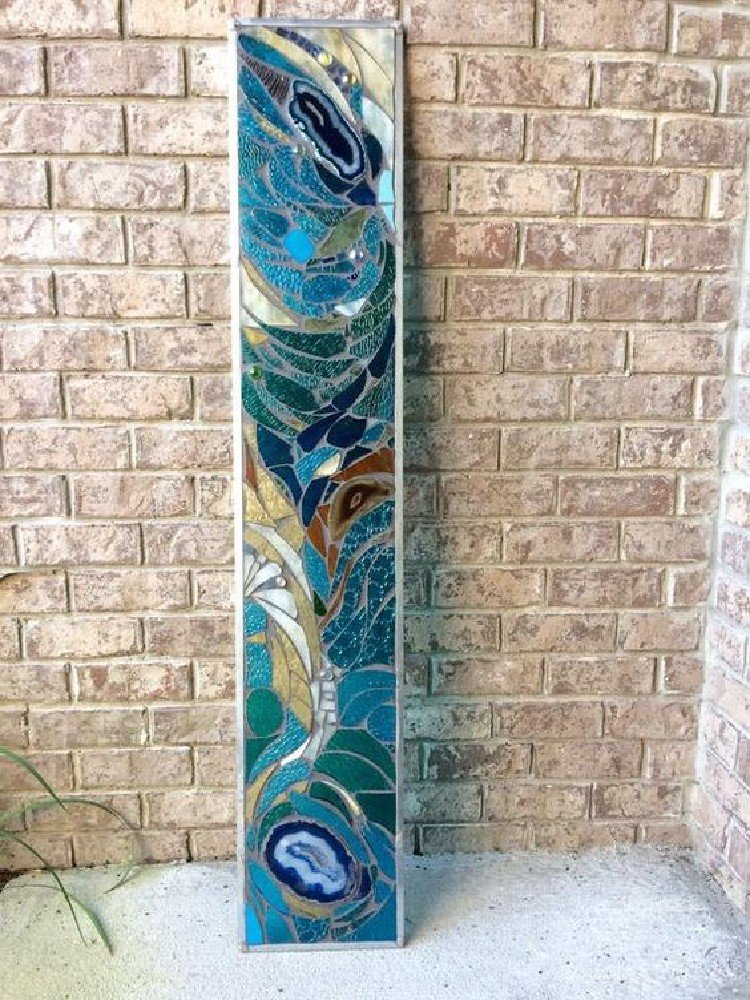Unique glass mosaic statement piece that is perfect for your bathroom.