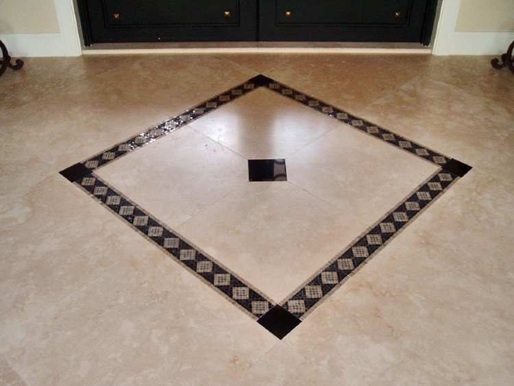 Subtle mosaic floor inlay centerpiece