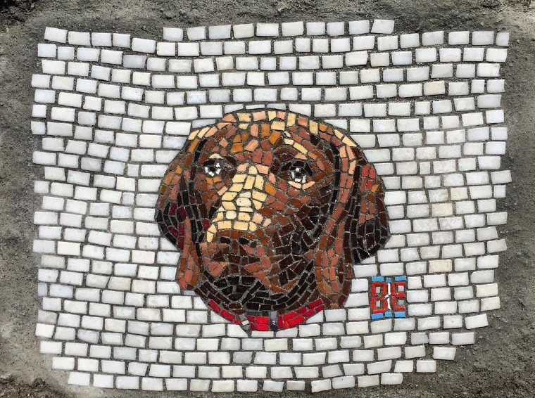 Pothole cover mosaic by Jim Bachor