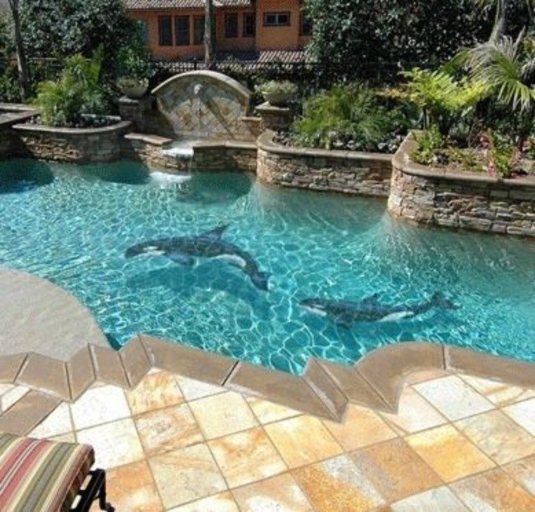 Pool mosaic artwork of orcas