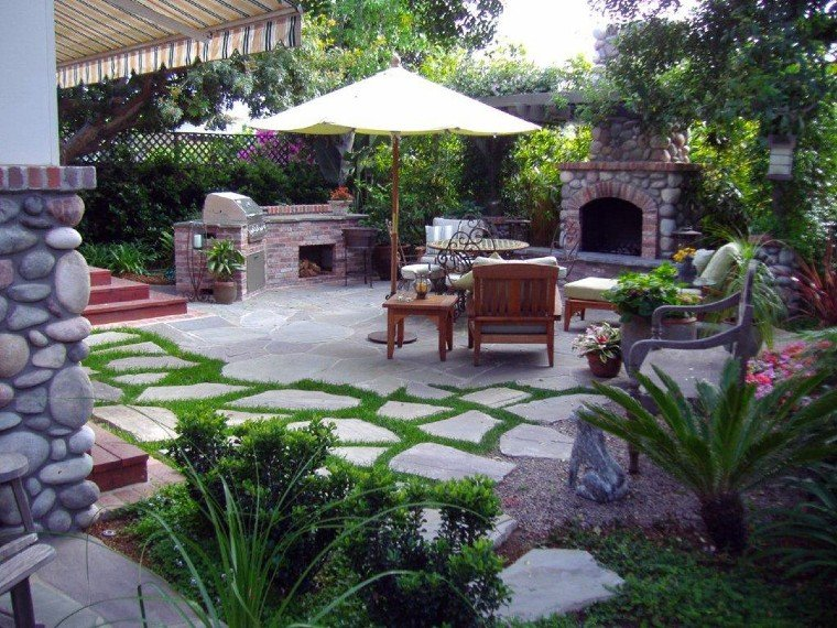 Stone grill work as a center piece in your backyard.