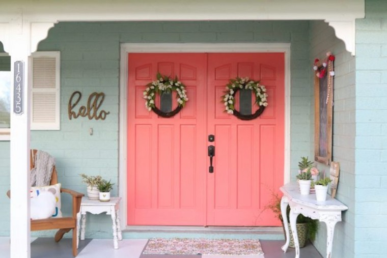 Large scale pink door as a statement piece.
