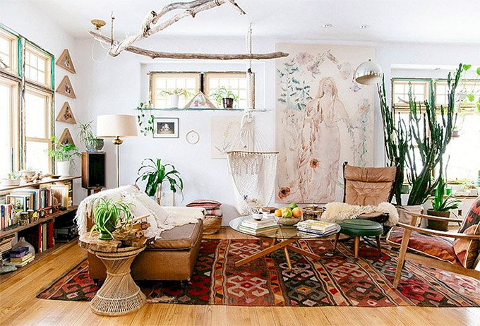 Scandinavian interiors with rugs, plants and wall decor. Interior Design inspiration by Mosaics Lab