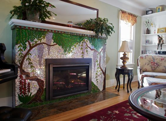 Nature-inspired fireplace mosaic artwork.