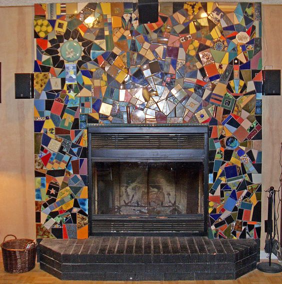 Eclectic fireplace mosaic design.