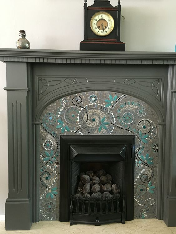 Beautiful monochromatic fireplace mosaic design.